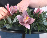 placing flowers in centerpiece