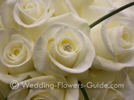 Diamante pins in bridal bouqet of roses