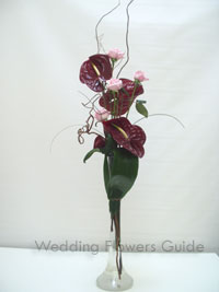 Tropical wedding flowers using anthuriums and roses