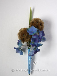 blue hydrangea boutonniere created for a wedding