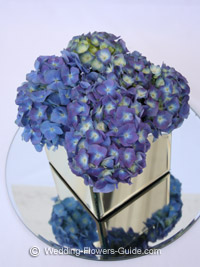 blue hydrangea wedding flowers in a cube mirror vase
