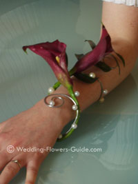 a wrist corage created using calla lilies
