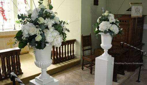 church wedding flowers at the altar of a chapel