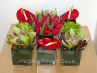Complementary wedding color theme - red and green flower arrangements