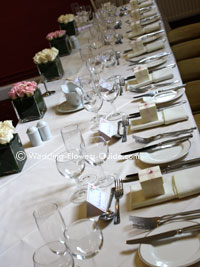 modern top table flowers at a wedding reception