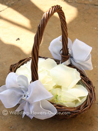 rose petals in a basket for a flowergirl at a wedding