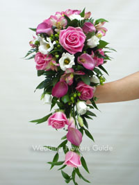 shower bouquet of pink roses and pink calla lilies