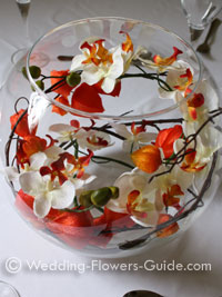 Silk wedding centerpiece in a goldfish bowl