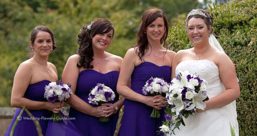 Summer bridesmaids' bouquets for a purple wedding color theme