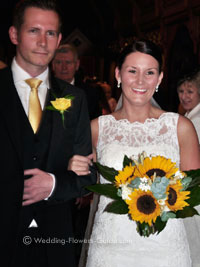bride with sunflower bridal bouquet, groom with rose buttonhole