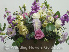 Vintage wedding centerpiece with roses and freesias